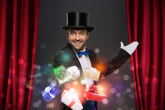 Cheerful magician performs the trick with box Stock Image