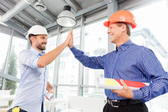 Cheerful male architect are greeting each other Stock Photo