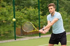 Cheerful male athlete playing tennis Stock Image