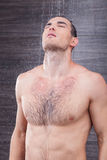 Cheerful male athlete is washing himself Royalty Free Stock Photography