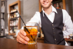 Cheerful male barman is working in bar Royalty Free Stock Image