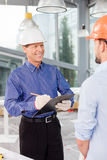 Cheerful male builders are working with joy Royalty Free Stock Photos