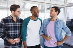 Cheerful male business colleagues standing together stock images