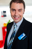 Cheerful male business executive in formals Royalty Free Stock Images