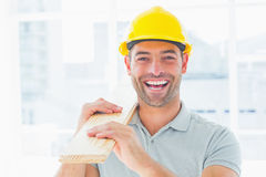 Cheerful male carpenter carrying planks Royalty Free Stock Photography