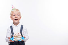 Cheerful male child is eating sweet food on royalty free stock photo