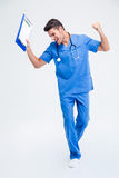 Cheerful male doctor celebrating his success. Full length portrait of a cheerful male doctor celebrating his success isolated on a white background Stock Photos