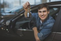 Handsome man choosing new automobile to buy royalty free stock photography