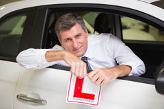 Cheerful male driver tearing up his L sign Royalty Free Stock Images