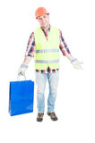 Cheerful male engineer doing shopping. And holding gift bag with copyspace isolated on white background Royalty Free Stock Photos