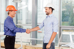 Cheerful male engineers made the deal with Royalty Free Stock Photography