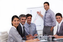Cheerful male executive reporting sales figures. In a meeting stock images
