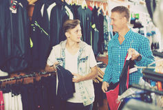 Cheerful male and his son shopping sport clothing Royalty Free Stock Photo