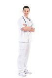 Cheerful male nurse posing with arms crossed Royalty Free Stock Image