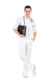 Cheerful male nurse posing with a laptop Stock Photos