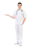 Cheerful male nurse showing product Royalty Free Stock Images