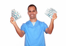 Cheerful male in nurse uniform holding cash money stock images