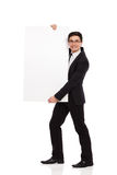 Cheerful male office worker standing with placard. Young male office worker standing with placard. Full length studio shot isolated on white Stock Photography