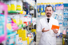 Cheerful male pharmacist suggesting useful drug Royalty Free Stock Photography