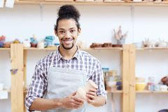 Cheerful male potter Stock Image