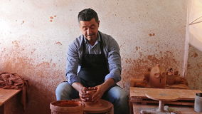cheerful male potter working with clay stock video