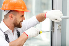 Cheerful male repairman is working with joy stock photos