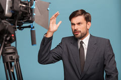 Cheerful male reporter is working with the Stock Photos
