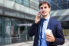Cheerful male standing outdoor and talking phone Royalty Free Stock Photos