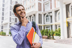 Cheerful male student with books in city Royalty Free Stock Photography