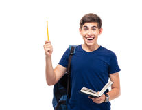 Cheerful male student holding book and pencil Stock Photography