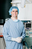 Cheerful Male Surgeon With Hands Clasped Stock Images
