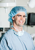Cheerful Male Surgeon In Operating Room. Portrait of cheerful male surgeon in operating room Stock Photography