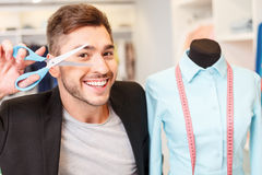 Cheerful male tailor enjoying his job Stock Image