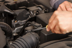 Cheerful male technician is repairing the vehicle Stock Photo