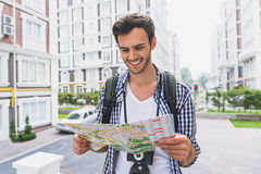 Cheerful male tourist planning new trip Stock Image