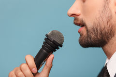 Cheerful male tv journalist is making his report Royalty Free Stock Photos