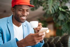 Cheerful male using mobile during relax Stock Image