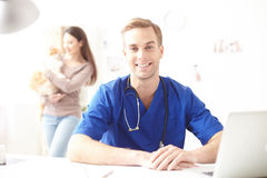 Cheerful male vet ready to examine patient Stock Photos