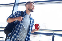 Cheerful male walking indoors Royalty Free Stock Photos