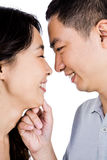 Cheerful man adoring woman. Cheerful men adoring women against white background Royalty Free Stock Images