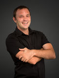 Cheerful man with arms crossed Royalty Free Stock Photography