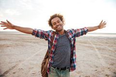Cheerful man with arms spread opened standing at the beach Stock Photography