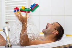 Cheerful man in bathtub Royalty Free Stock Photos