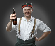 Cheerful man with a beer bottle. Royalty Free Stock Photo