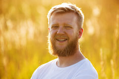 Cheerful man with a big red beard Stock Image