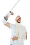 Cheerful man with broken hand and crutch cheering Royalty Free Stock Photography