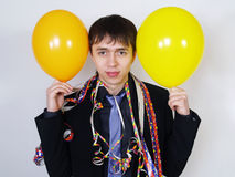 Cheerful man in a business suit with balloons Stock Image