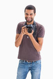 Cheerful man with camera around his neck Stock Image