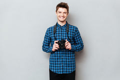 Cheerful man with camera posing. Cheerful and laughing man with camera posing stock images