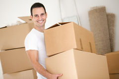Cheerful man with cardboard box Royalty Free Stock Image